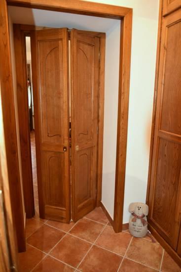 Porta a soffietto in legno su misura fabbrica di Portoni infissi e ...